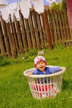 Naughty-Baby-in-laundry-basket