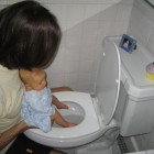 Nappy Free Baby On Toilet