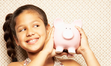 Children and saving girl with piggy bank