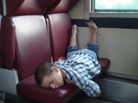 Top Tips For Finding Cheaper Train Tickets asleep on train