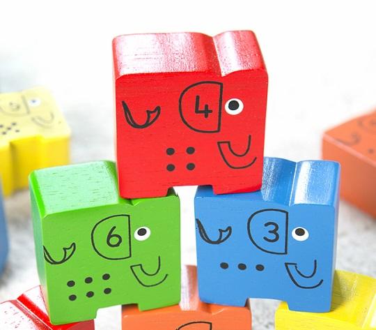 Elephant stacking blocks