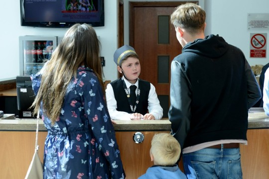 Child Hotel Concierge Noah Reeves-Walters serves customers at the Drayton Manor Hotel